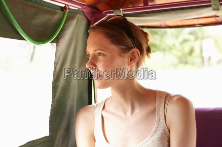 woman looking out car window