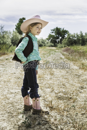 girl wearing cowboy hat and boots
