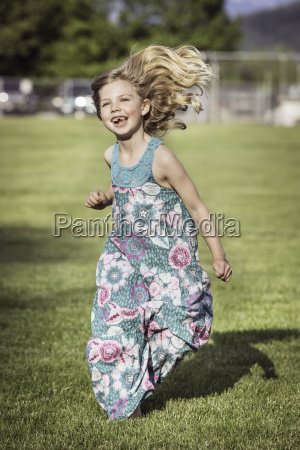 girl wearing sundress running