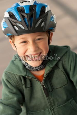 boy wearing bike helmet outdoors