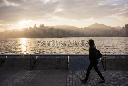 side view of young woman walking