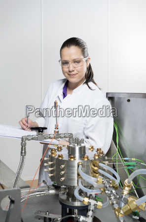 portrait of female scientist doing research