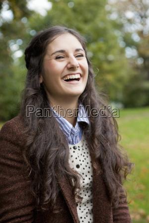 smiling girl standing in park