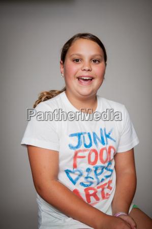 studio portrait of girl wearing tshirt