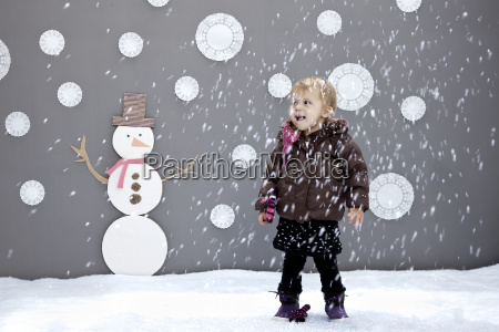 baby girl with snow and
