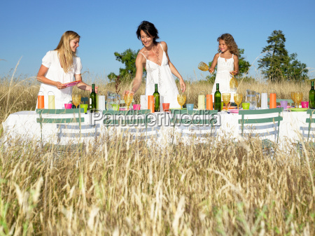 girls setting the table outdoors