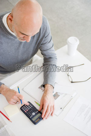 man sitting at office desk