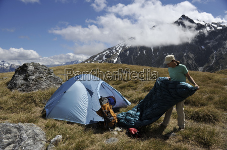 mid adult woman camping in mountains