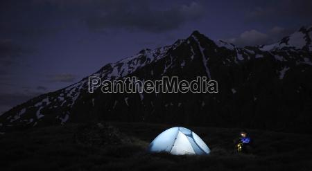 tent illuminated at night new zealand