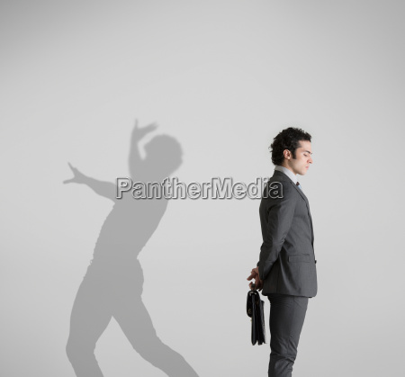 man with shadow in background dancing