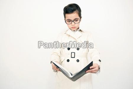girl in eyeglasses reading book