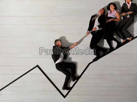 business people pulling each other