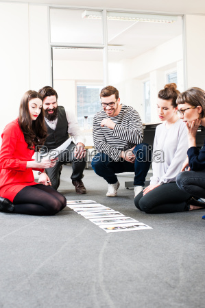 designers laying paper on floor