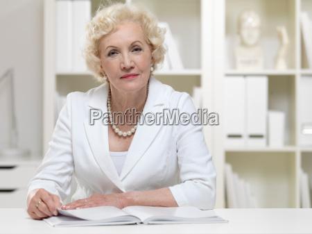 senior businesswoman with book