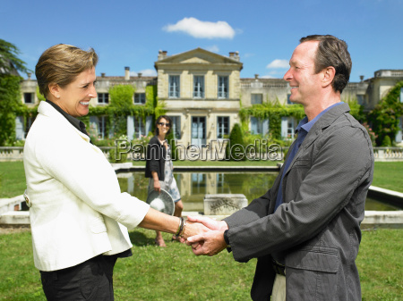 man and woman shaking hands after
