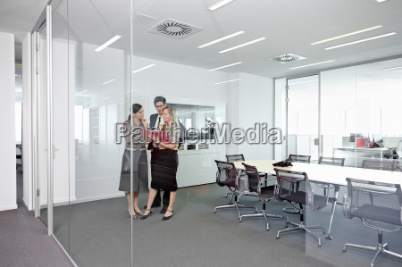 business people standing in conference room