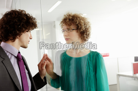 businessman and woman holding hands against