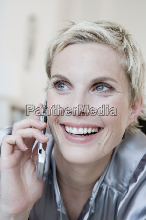 woman on sofa with cell phone
