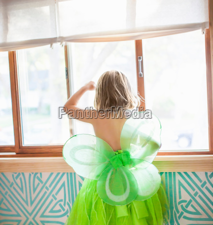 back view of child in green