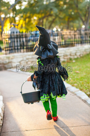back view of child in witch