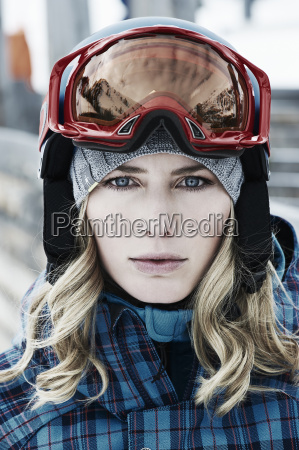 young woman wearing skiwear and goggles