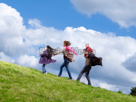 family of four walking up windy