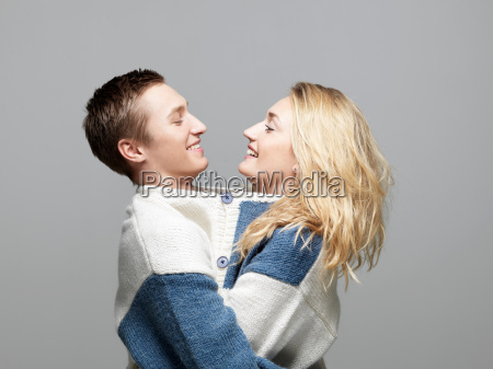 young couple wearing same sweater