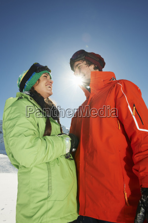 couple wearing skiwear low angle kuhtai