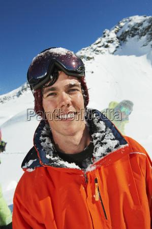 portrait of man wearing orange ski