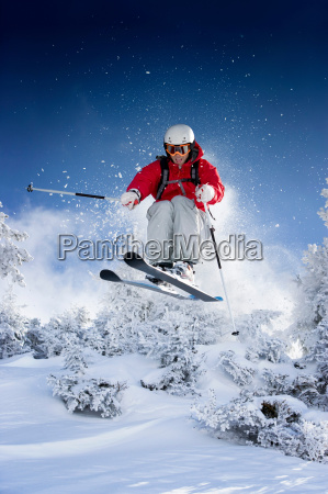 skier jumping towards camera