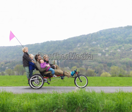 family riding together on three wheeled