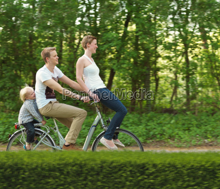 family with one child riding on