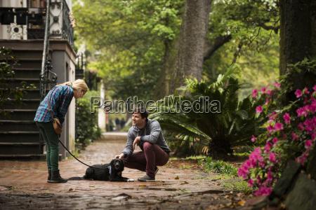 couple with dog behind house savannah