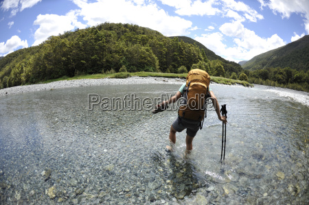 mid adult woman wading through water