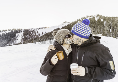 couple kissing on vacation achenkirch tirol