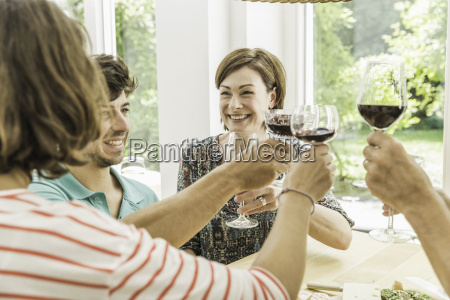 five adult friends making a toast