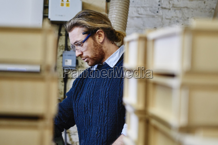 young man between letterpress trays in