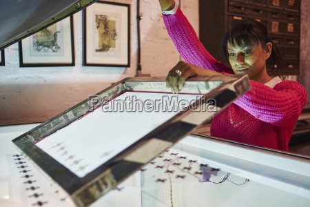 mid adult woman preparing screen on