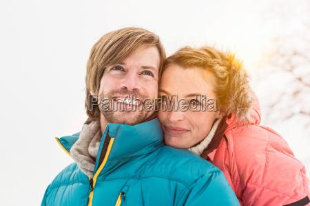portrait of couple wearing winter coats