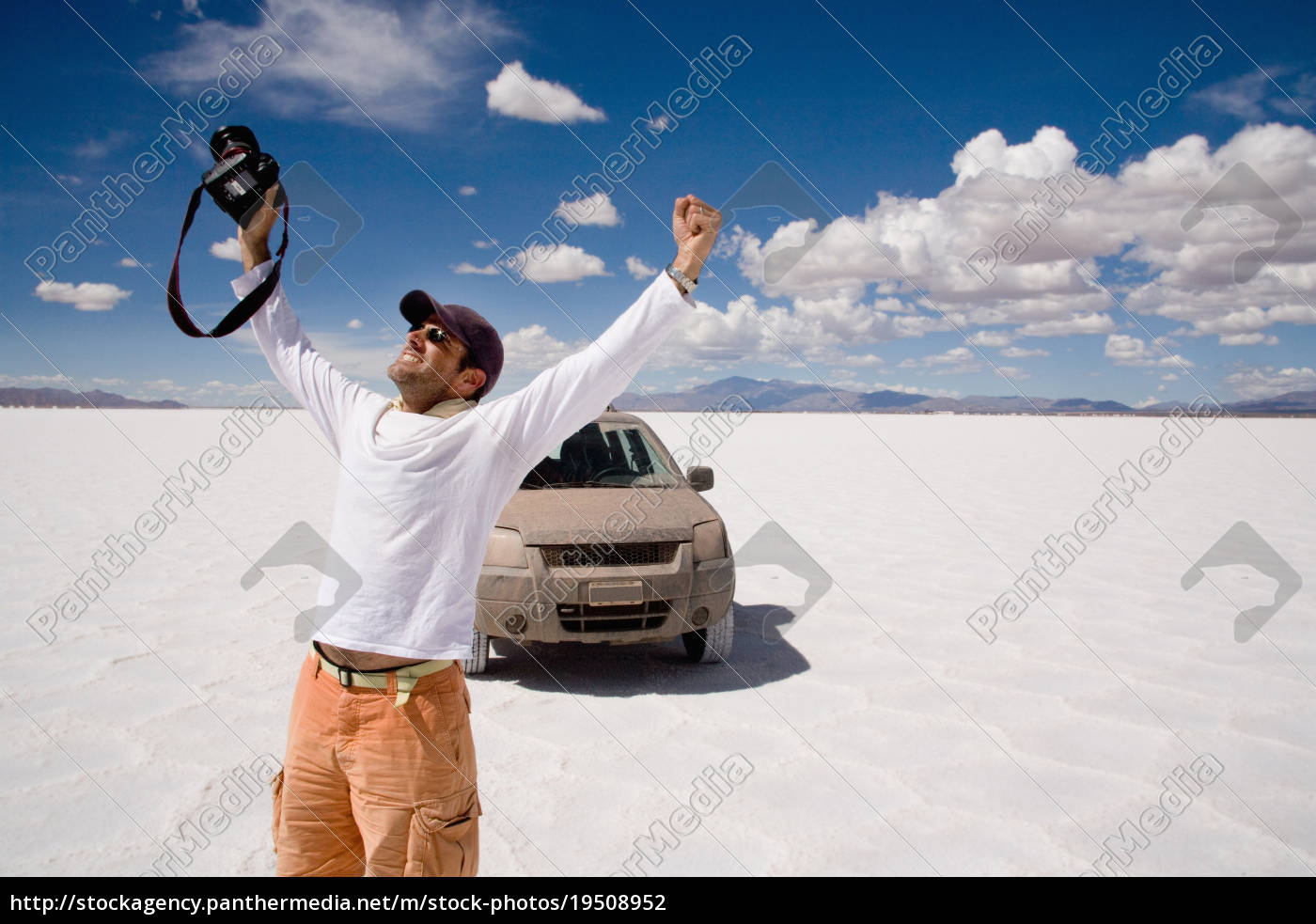 photographer, celebrates, in, a, salt, field, - 19508952