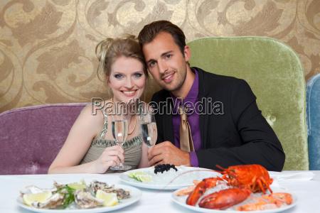 couple drinking wine at restaurant