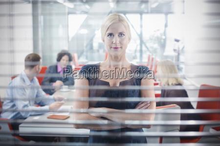 mid adult woman behind window