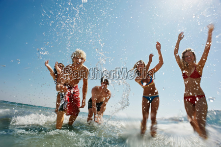 group of people splashing in the