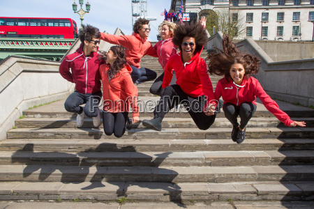 small group of dancers mid air