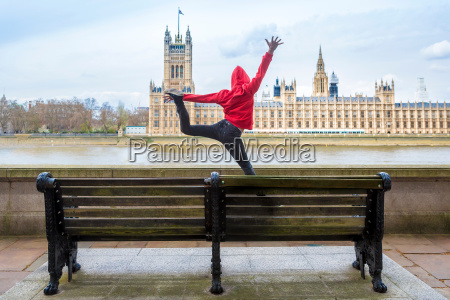 young male dancer mid air in