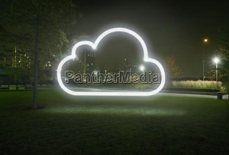 glowing cloud symbol in city park
