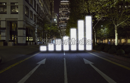 glowing bar graph in city street