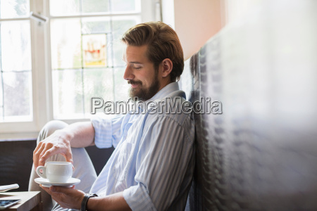 portrait of man holding cup of