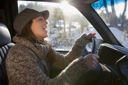 woman singing whilst driving