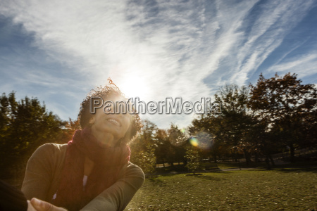 young woman in park on autumn